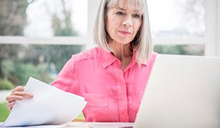 Senior business lady working through papers
