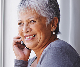 happy senior woman on a phone call